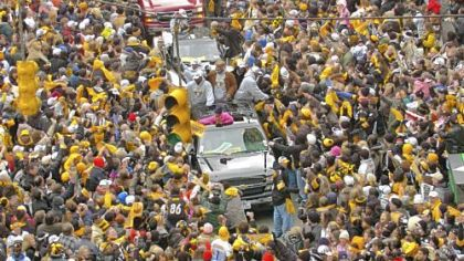 Ben Roethlisberger and Charlie Batch, in the first truck in foreground, ride through a sea of fans lining Fifth Avenue during the Steelers Super Bowl XL Victory Parade in 2006.