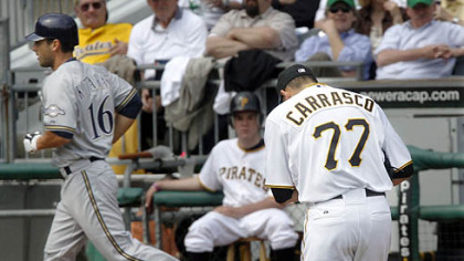The Brewers' George Kottaras trots past Pirates reliever D.J. Carrasco after his leadoff home run in the fifth inning.