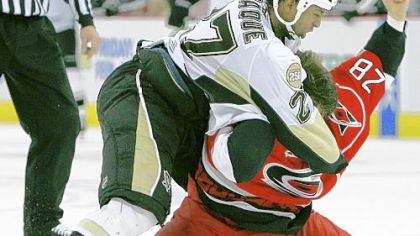 The Carolina Hurricanes' Wade Brookbank (28) and former Penguin Georges Laraque fight during a 2008 game.