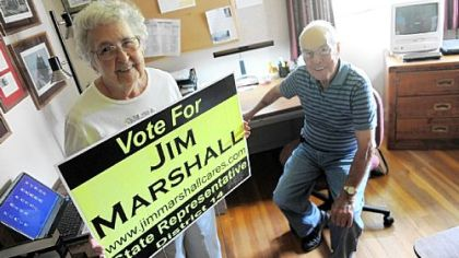 State House candidate Jim Marshall's parents, Bob and Peg Marshall, pose for a portrait inside the room at their home which served as their son's campaign headquarters.