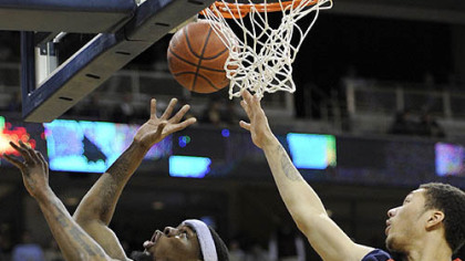 Pitt forward Nasir Robinson gets a shot up against Robert Morris forward Dallas Green in the second half.