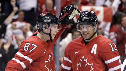 Sidney Crosby congratulates Canada linemate Jarome Iginla on the second of his three goals Tuesday.