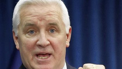 Attorney General Tom Corbett addresses a news conference on Tuesday in Harrisburg.