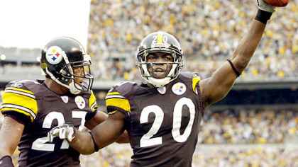 File photo of Bryant McFadden celebrating with then-teammate Willie Williams after intercepting against Jacksonville.