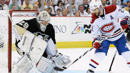 Canadiens forward Brian Gionta attempts to redirect a puck as Penguins goaltender Marc-Andre Fleury defends the net during Sunday's at Mellon Arena.