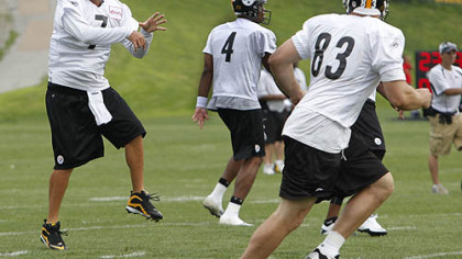 Steelers quarterback Ben Roethlisberger passes to tight end Heath Miller  during the first practice session at the NFL football team's training camp in Latrobe on Saturday.