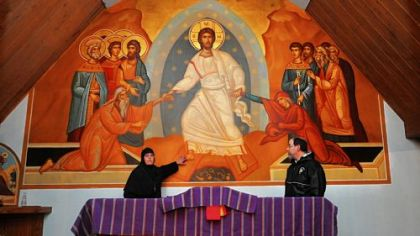 Mother Alexandra and Father Anthony Yazge with the huge resurrection icon at Antiochian Village outside Ligonier.