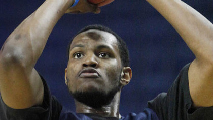 West Virginia's Devin Ebanks shoots during practice.