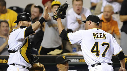 Pirates pitcher Evan Meek high fives catcher Ryan Doumit during last night&#039;s game at PNC Park.