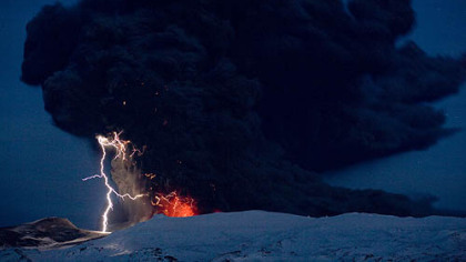 Lightning can be seen amid the lava and ash erupting from the vent of the Eyjafjoll volcano in central Iceland in April.