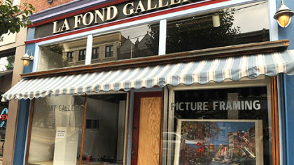 A sheet of plywood covers the front door of La Fond Galleries, on the South Side. A Pitt football player allegedly threw a man through this door.