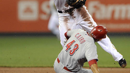 Pirates second baseman Neil Walker gets Reds Miguel Cairo out at second base on a double play in the first inning.