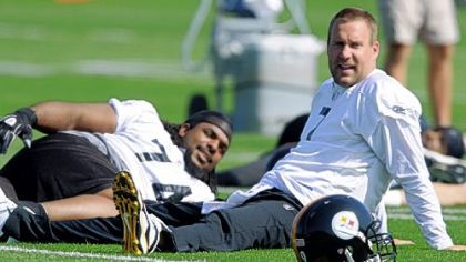 Pittsburgh Steelers quarterback Ben Roethlisberger stretches with tackle Willie Colon before the first day of mandatory off-season workouts.