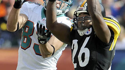 Steelers cornerback Deshea Townsend intercepts a pass in front of Dolphins wide receiver Greg Camarillo during a game at Landshark Stadium in Miami earlier this month.