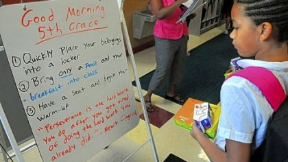 Fifth-grader Patricia Brown, 10, checks the morning message board for directions at Propel McKeesport.
