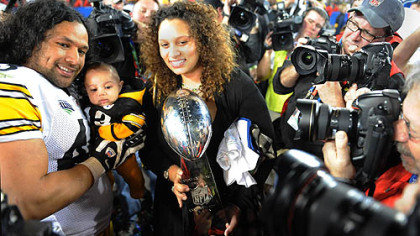 Troy and Theodora Polamalu with son Paisios after the 2009 Super Bowl.