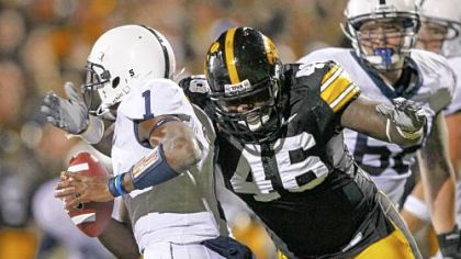 "Iowa defensive tackle Christian Ballard sacks Penn State's Rob Bolden, left, Saturday. After the game, Lions coach Joe Paterno opined of his quarterback, ""Maybe we're asking too much of the freshman."""