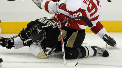 Red Wings forward Johan Franzen collides with Penguins forward Evgeni Malkin during the first period.
