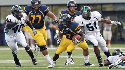 West Virginia's offensive line has helped running back Noel Devine, center, rush for 223 yards this season.