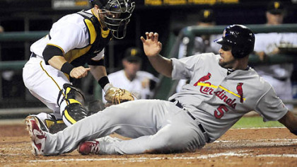 Pirates catcher Ryan Doumit is too late with the tag on the Cardinals' Albert Pujois hustling home from second base in the fifth inning Monday at PNC Park.