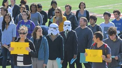 Theodore Dasher, 21, left, and Shazwan Azizan, 22, both Carnegie Mellon University students, wear Star Wars storm trooper masks while participating in a campus celebration of the first World Statistics Day Wednesday. About 150 CMU faculty and staff formed a human histogram based on their height.