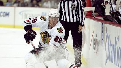 Blackhawks forward Bryan Bickell handles the puck.