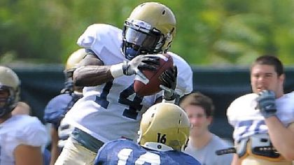 Greg Cross goes up to pull in a 23-yard pass in front of Kolby Gray in Saturday's scrimmage.