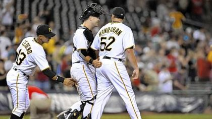 The Pirates&#039; Ronny Cedeno and Chris Snyder congratulate Joel Hanrahan  after beating the Marlins, 7-1, Aug. 16 at PNC Park.