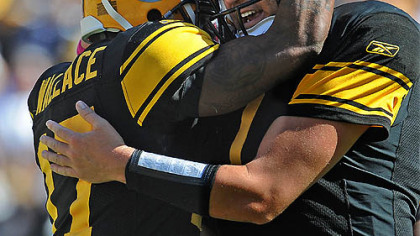 Mike Wallace is greeted by quarterback Ben Roethlisberger after making a touchdown catch in the second quarter.