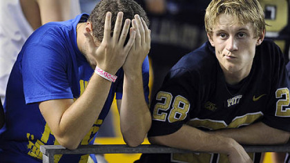 Pitt fans watch the final minutes of their team's loss to Miami at Heinz Field Thursday.