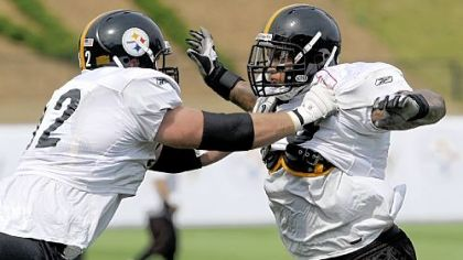 Steelers first-round pick Maurice Pouncey, right, goes through drills with teammate Justin Hartwig during the first day of the team's 2010 training camp in Latrobe last month.