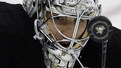 Penguins goalie Marc-Andre Fleury stops a shot in the first period of Friday&#039;s game at Consol Energy Center.