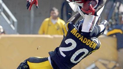 Steelers cornerback Bryant McFadden upends Atlanta's Jerious Norwood in the fourth quarter Sunday at Heinz Field.