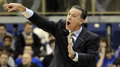 Pitt coach Jamie Dixon yells to his team in the first half of Wednesday's game against American at the Petersen Events Center. Dixon earned his 200th win.