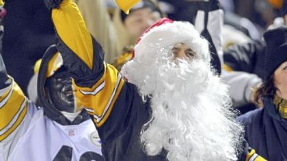 All he wants for Christmas ... a festive Steelers fan cheers on his team against the Carolina Panthers Thursday night.