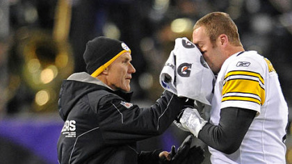 Steelers head trainer John Norwig stops the bleeding from Ben Roethlisberger&#039;s fractured nose Sunday in Baltimore.