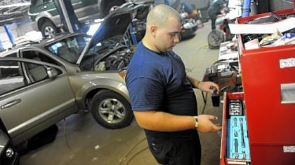 David Abbott, 19, of Houston, Washington County, works as an auto technician at South Hills Chrysler Jeep Kia in Peters.