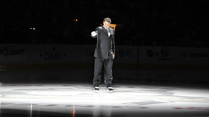 Penguins owner Mario Lemieux pours out water from the Mellon Arena onto the ice of the Consol Energy Center.