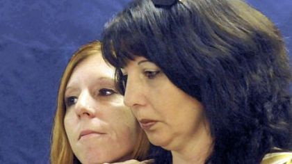 Sisters of the late Jerry Lee Cushey Jr., Gina Thorn, left, of Fairmont, W.Va., and Sonya Helmantoler, of Monongahela, listen as Washington County District Attorney Steven Toprani talks about the arrests in the killing of their brother.