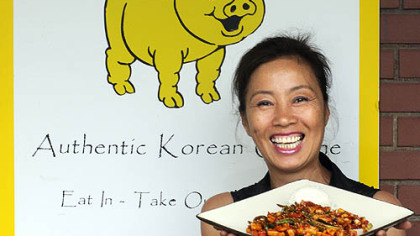 Yong Kwon, owner/chef at the Golden Pig in Cecil, presents one of her menu items-- oh jing uh bockeum (spicy squid that is broiled and seasoned).