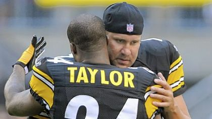Steelers quarterback Ben Roethlisberger, shown here hugging teammate Ike Taylor before the start of the preseason game against Detroit at Heinz Field Saturday night, did not play and was mainly a source of encouragement on the sidelines.