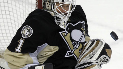 Penguins goaltender Brent Johnson makes a first-period save.