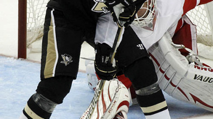 Penguins forward Evgeni Malkin can''t get a shot past Red Wings goaltender Chris Osgood in the first period.