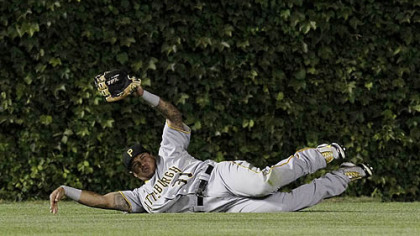 Pirates left fielder Jose Tabata makes a sliding catch of a fly ball by Chicago Cubs&#039; Tyler Colvin during the fourth inning last night at Wrigley Field in Chicago.