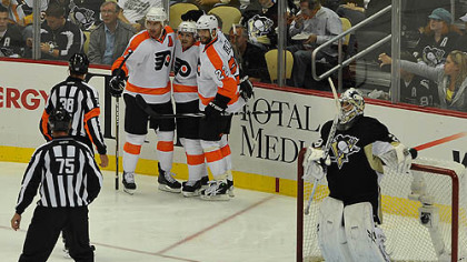 Flyers forwards Jeff Carter, right, Danny Briere, center, and Ville Leino celebrate after a second period goal against Penguins goaltender Marc-Andre Fleury during Thursday&#039;s game at Consol Energy Center.