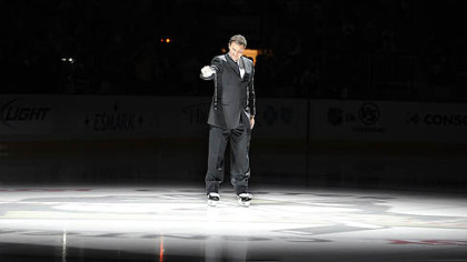 Penguins owner Mario Lemieux pours out water from the Mellon Arena to the ice of the Consol Energy Center prior to Thursday's game.