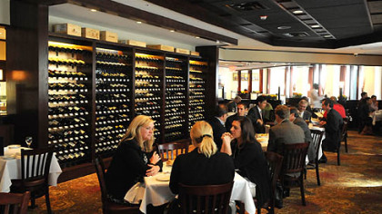 At The Carlton, Downtown, the wine library, where diners can browse and select a bottle, is at left.