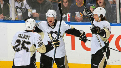 Penguins forwards Maxime Talbot, Arron Asham and defenseman Kris Letang celebrated a first period against the Sabres at HSBC Arena in Buffalo Saturday.