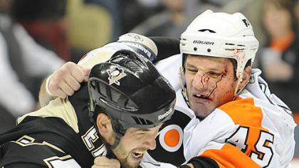 Deryk Engelland fights the Flyers' Jody Shelly in the first period Friday at Consol Energy Center.