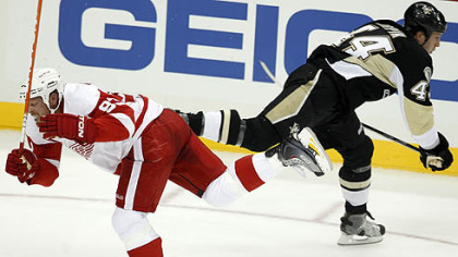 Red Wings forward Johan Franzencollides with Penguins defenseman Brooks Orpik in the first period. Franzen was helped off the ice after the collision.